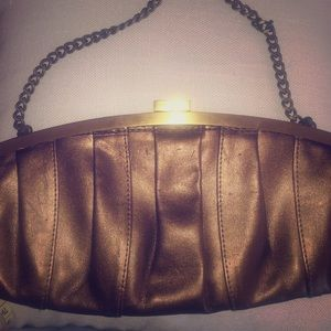 Cache clutch w strap and satin interior bronze
